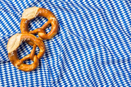 menue: Two pretzels on a  bavarian diamond pattern