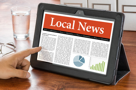local: A tablet computer on a desk - Local News Stock Photo
