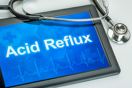 acid reflux: Tablet with the diagnosis Acid Reflux on the display