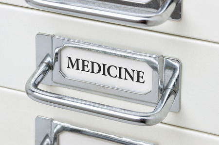 cardbox: A drawer cabinet with the label Medicine Stock Photo