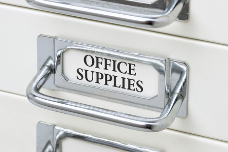 cardbox: A drawer cabinet with the label Office Supplies Stock Photo
