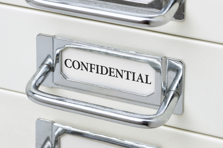 cardbox: A drawer cabinet with the label Confidential Stock Photo
