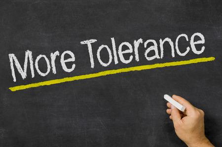 black ancestry: More Tolerance written on a blackboard
