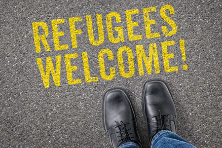 helpfulness: Text on the floor - Refugees welcome Stock Photo
