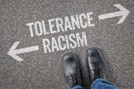 racism: Decision at a crossroad - Tolerance or Racism Stock Photo