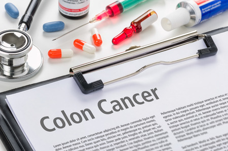 colonoscopy: The diagnosis Colon Cancer written on a clipboard