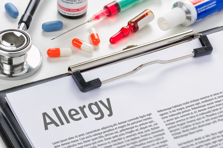 food allergy: The diagnosis allergy written on a clipboard Stock Photo