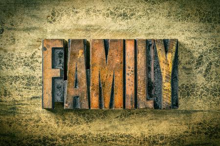 family life: Antique letterpress wood type printing blocks - Family Stock Photo