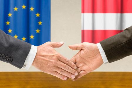 representatives: Representatives of the EU and Austria shake hands Stock Photo