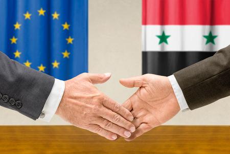 representatives: Representatives of the EU and Syria shake hands