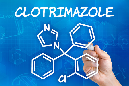 vaginal: Hand with pen drawing the chemical formula of Clotrimazole Stock Photo