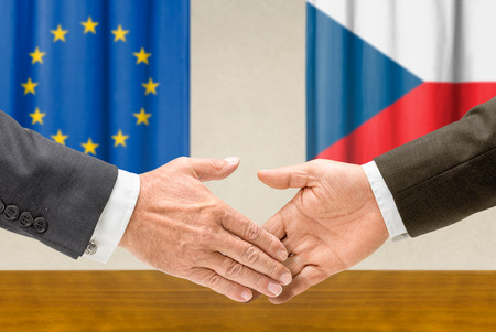 foreign nation: Representatives of the EU and the Czech Republic shake hands Stock Photo
