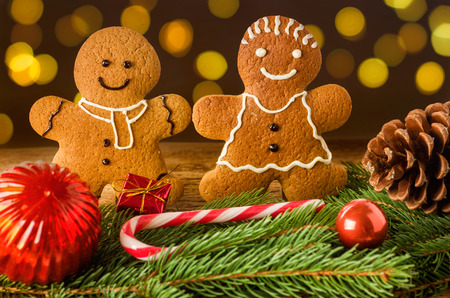 gingerbread cookies: A gingerbread couple with christmas decorations Stock Photo