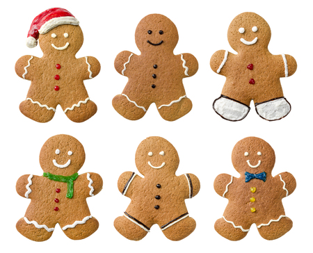 galletas de navidad: Collection of various gingerbread men on a white background Foto de archivo