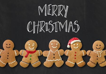 Kerstkaart met peperkoek mannen Stockfoto