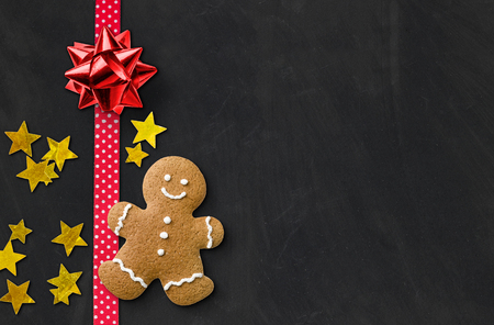 A gingerbread man on a blackboard