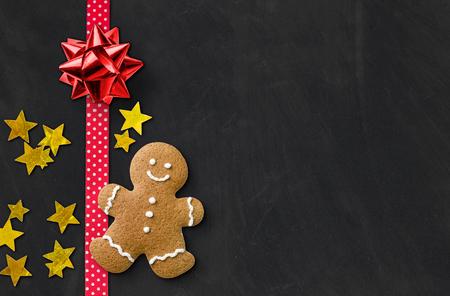 A gingerbread man on a blackboard