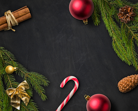 christmas bows: Christmas Decorations on a blackboard Stock Photo