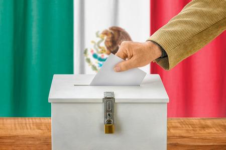 plebiscite: Man putting a ballot into a voting box - Mexico