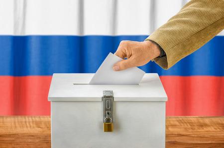 plebiscite: Man putting a ballot into a voting box - Russia