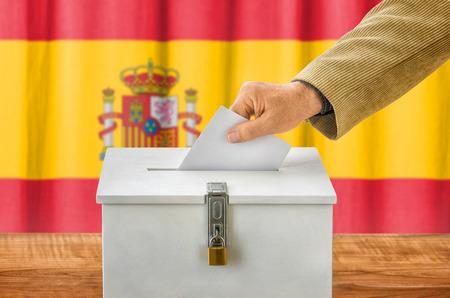 voting box: Man putting a ballot into a voting box - Spain Stock Photo