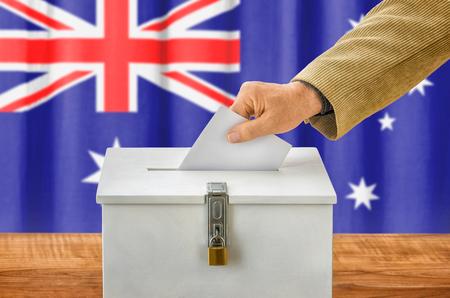 plebiscite: Man putting a ballot into a voting box - Australia