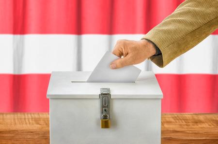 voting box: Man putting a ballot into a voting box - Austria