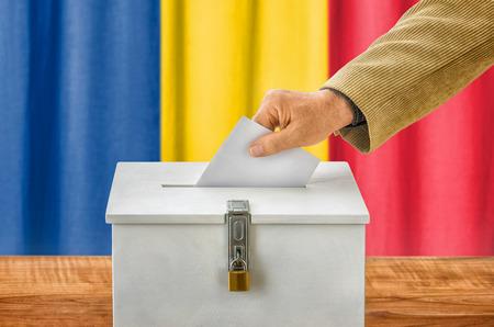 voting box: Man putting a ballot into a voting box - Romania