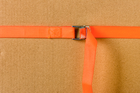 lashing: Orange cam buckle strap Stock Photo