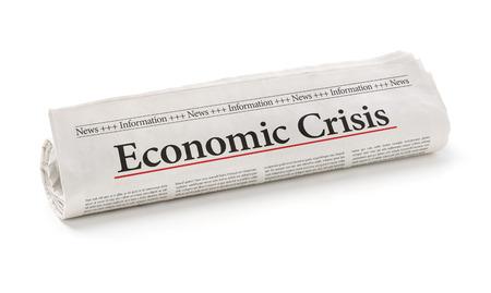 crisis economica: Periódico rodado con el titular crisis económica Foto de archivo