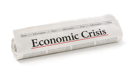 crisis: Rolled newspaper with the headline Economic Crisis Stock Photo