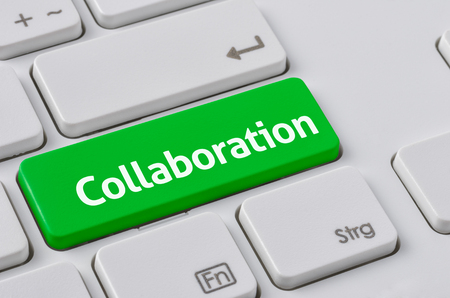 collaboration: A keyboard with a green button - Collaboration