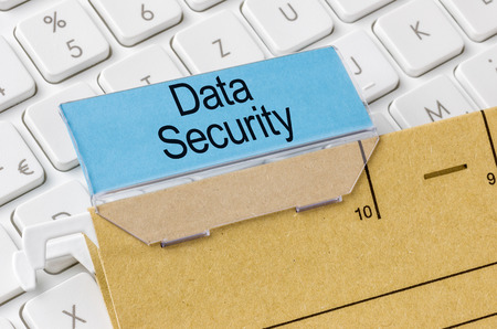 indexing: A brown file folder labeled with Data Security Stock Photo