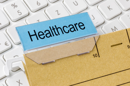 archival: A brown file folder labeled with Healthcare Stock Photo