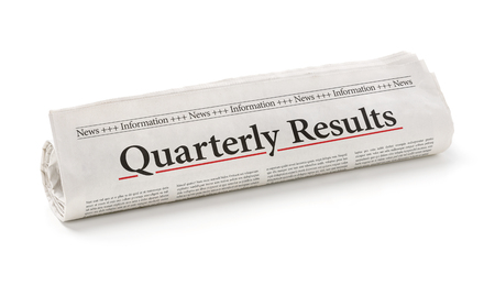 Rolled newspaper with the headline Quarterly Results Banco de Imagens - 49221791