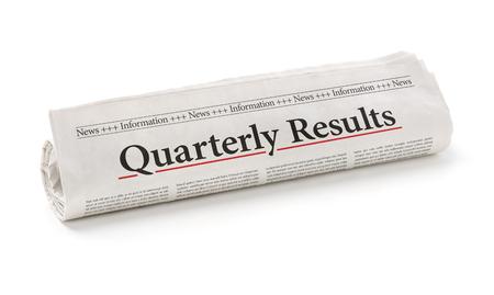 Rolled Zeitung mit der Schlagzeile Quartalsergebnisse Standard-Bild - 49221791