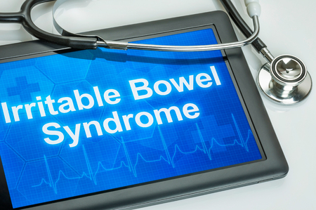 Tablet with the diagnosis Irritable bowel syndrome on the display Banco de Imagens - 49746912