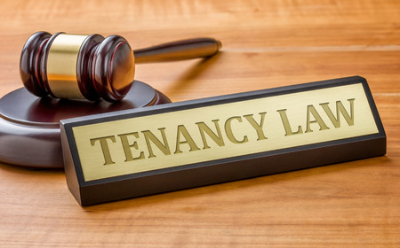 name plate: A gavel and a name plate with the engraving Tenancy Law Stock Photo
