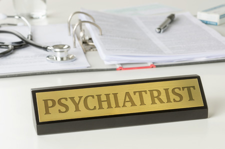 name plate: Name plate on a desk with the engraving Psychiatrist
