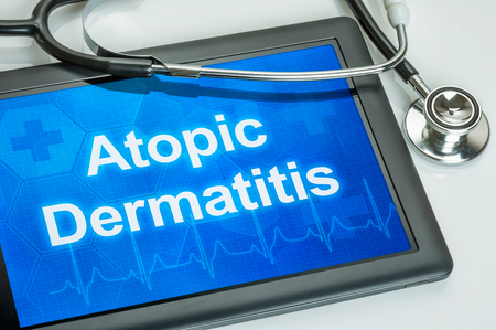 atopic: Tablet with the diagnosis Atopic Dermatitis on the display