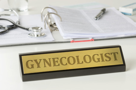 Name plate on a desk with the engraving Gynecologist Stock Photo