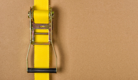 strap on: Yellow ratchet strap with copy space
