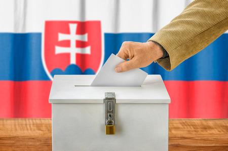 plebiscite: Man putting a ballot into a voting box - Slovakia Stock Photo