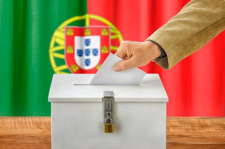 voting box: Man putting a ballot into a voting box - Portugal
