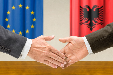 representatives: Representatives of the EU and Albania shake hands