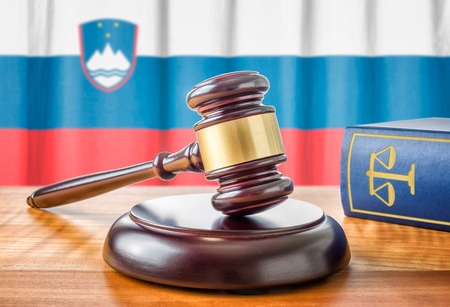 statute: A gavel and a law book - Slovenia