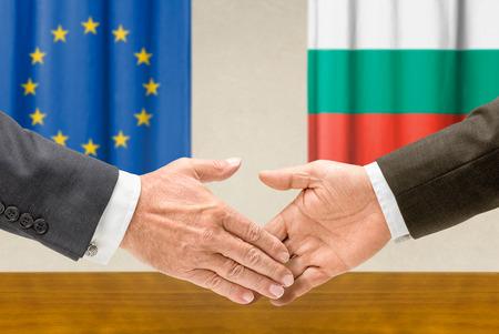 foreign nation: Representatives of the EU and Bulgaria shake hands