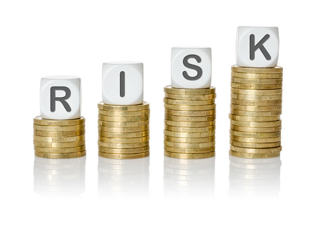 negative returns: Coin stacks with letter dice - Risk