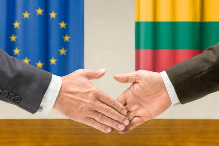 representatives: Representatives of the EU and Lithuania shake hands