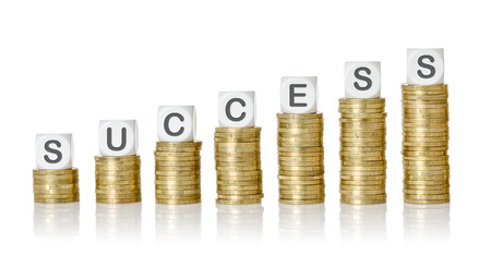 financial diversification: Coin stacks with letter dice - Success